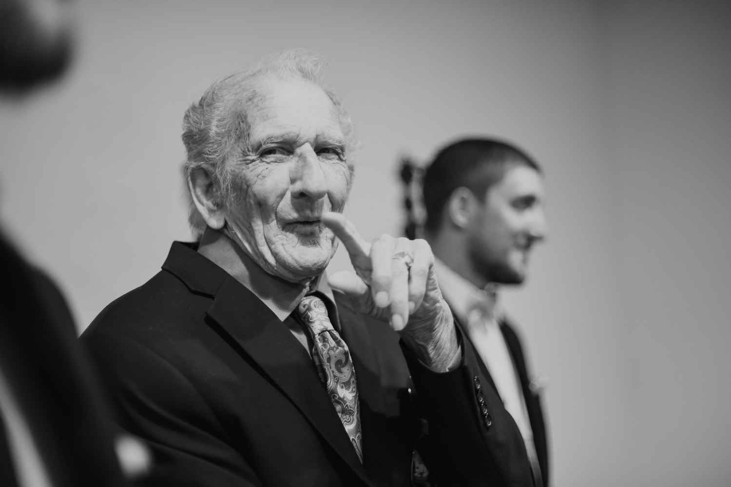 grandfather waving on a wedding day in wilmington