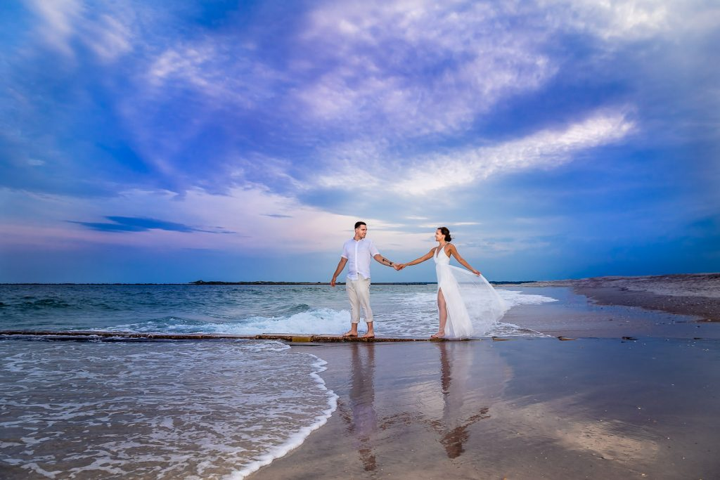 bride and groom walking on Wrightsville beach at sunset
